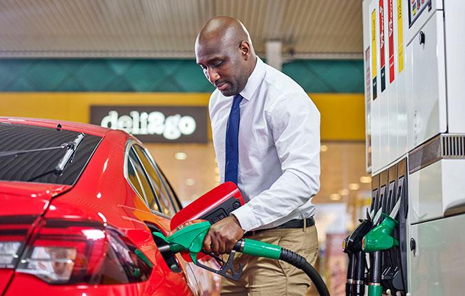 Man pumping gas at a Shell station